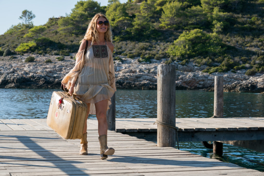 "LILY JAMES stars as Young Donna in ""Mamma Mia! Here We Go Again."" Ten years after ""Mamma Mia! The Movie,"" you are invited to return to the magical Greek island of Kalokairi in an all-new original musical based on the songs of ABBA."